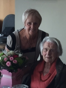 Immediate Past Captain, Cindy Good presents Biddy with flowers from the Hayling Ladies.